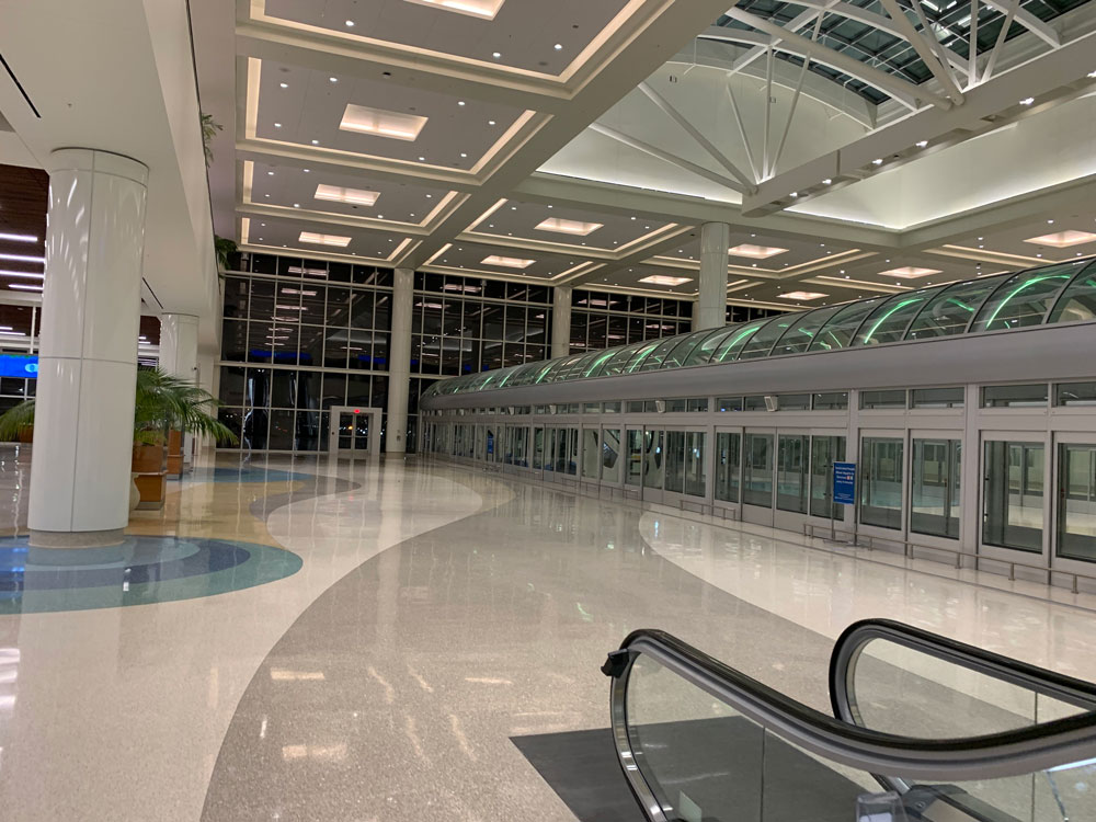 The way the CDC wants it: an empty section of Orlando International Airport. (© FlaglerLive)