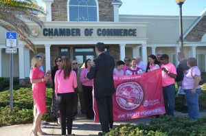 The flag-raising ceremony at the Chamber of Commerce Monday morning. Click on the image for larger view. (© FlaglerLive)