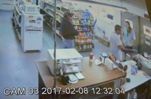 The jury saw a long clip from surveillance video at Cody's Corner on Feb. 8, 2017, showing Charles Singer buying a few goods in what appears to be the last video that showed him alive. He is the man in the foreground, in the white shirt. Click on the image for larger view. (c FlaglerLive)