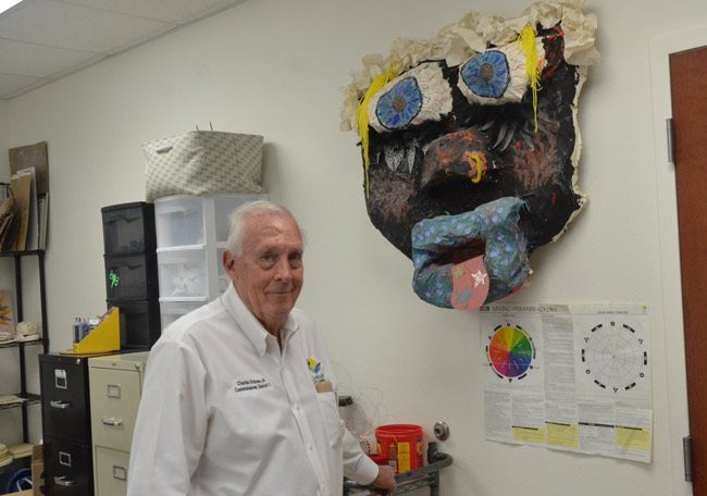 Flagler County Commissioner Charlie Ericksen, seen here during a visit at Stewart-Marchman-Act's Women Assisting Recovering Mothers program in Bunnell (he was in the art therapy room), marked his 75th birthday Saturday. (© FlaglerLive)