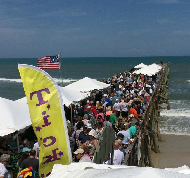 It's a wonder it stayed standing, or maybe not: the Flagler Beach Pier is more resilient than we know, and Saturday residents came out in force to Cheer at the Pier and celebrate the Flagler Centennial, the first time the pier has been open to so many people since it had to close after being damaged by Hurricane Matthew. Its eastern end is still off limits: it's not even there, and it won't be for a long time yet, but pier repairs are progressing, and the structure should  fully functional by the end of May. (c FlaglerLive)