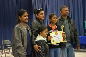 Runner-up Chevaney Chandradat of Belle Terre Elementary and her family. (© FlaglerLive)
