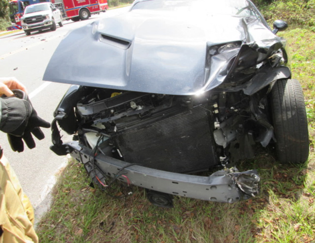 Deputy Austin Chewning's agency-issued Dodge Challenger sustained $15,000 in damages in the Hammock crash Saturday. (FCSO)