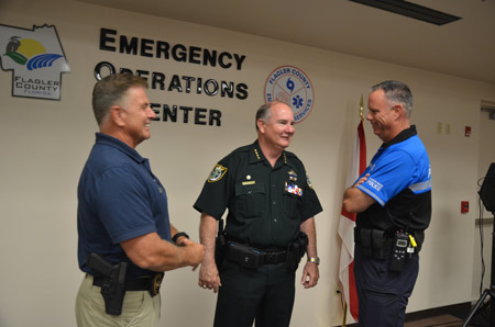 Sheriff Rick Staly, center, with Bunnell Police Chief Tom Foster, left, and Flagler Beach Police Chief Matt Doughney. (© FlaglerLive)