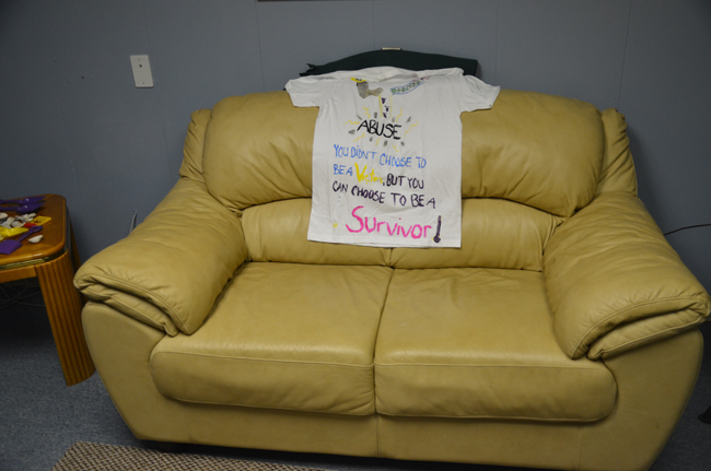 The couch in the interview room where children who are victim of sexual abuse are usually interviewed by a professional of the Children Advocacy Center. The shirt was made by a youth. (© FlaglerLive)