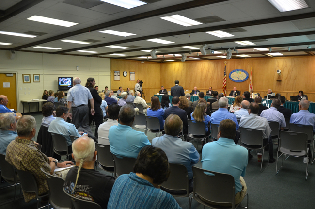The Palm Coast City Council's meeting on a new city hall drew an overflow crowd Tuesday and a stream of 38 people who addressed the council on the matter, a majority of them opposed to the proposal. (© FlaglerLive)