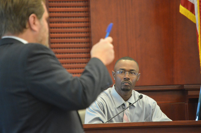 C.J. Nelson answering questions from his attorney, Josh Davis, in court this morning. Nelson faces a felong child abuse charge stemming from a confrontation with a 16-year-old girl at Epic Theater in Palm Coast in October 2016. (© FlaglerLive)