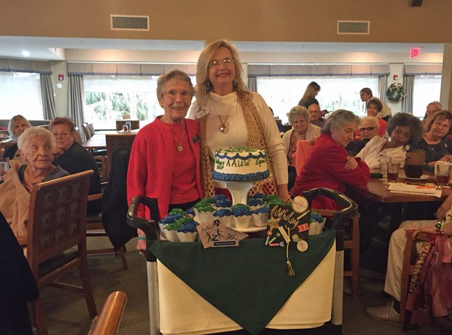 The American Association of University Women on Saturday celebrated the 90th birthday of Mary Ann Clark, left, who appears here with the group's president, Kimble Medley. (© FlaglerLive)