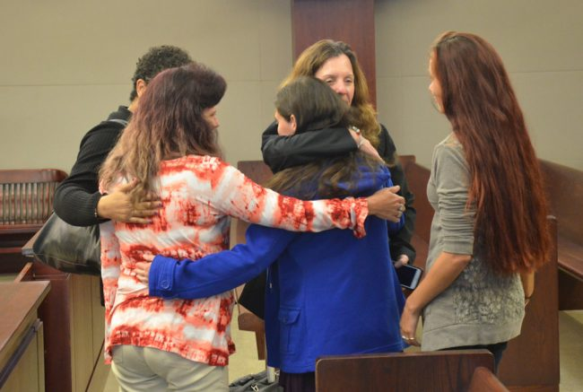 Assistant State Attorney Melissa Clark and the family after the verdict. Tiffany Norman is in the blue jacket. (© FlaglerLive)