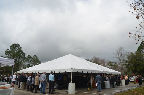 To some, it may have appeared as if the clouds were gathering over the sheriff's office during the swearing in. In fact, the clouds largely dissipated soon after, though skies were nowhere near entirely blue. (© FlaglerLive)
