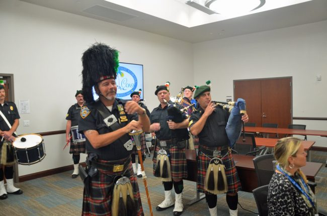 The Coastal Florida Police and Fire Pipes and Drums prepare. Click on the image for larger view. (© FlaglerLive)