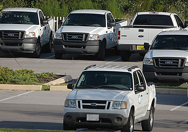 Palm Coast residents are not quite enthusiastic about code enforcement, whose visibility is emphasized by the city's fleet of frequent-driving trucks (seen here in a  file photo).  But the city has no plans to alter its approach. (© FlaglerLive)