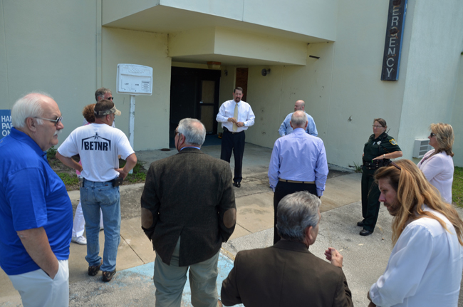 County Administrator Craig Coffey, facing the camera, as he was briefing county commissioners and others before tours of the old Memorial hospital in May. (© FlaglerLive)