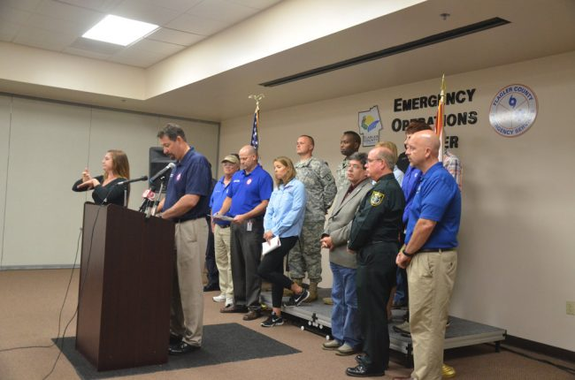 Craig Coffey at the podium during a press conference the night before Hurricane Matthew's closest approach to Flagler. Click on the image for larger view. (© FlaglerLive)