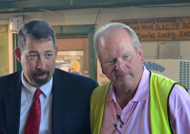 Flagler Beach City Manager Larry Newsom has again applied for work elsewhere, this time in Putnam County, where one of the people facilitating the search is Flagler County Administrator Craig Coffey, right, who frequently works with Newsom on beach-related issues. (© FlaglerLive)