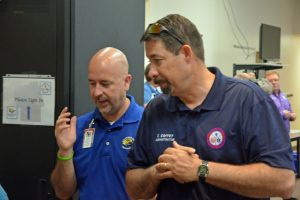 County Administrator Craig Coffey, right, and Superintendent Jacob Oliva at the county's Emergency Operations Center. (c FlaglerLive)