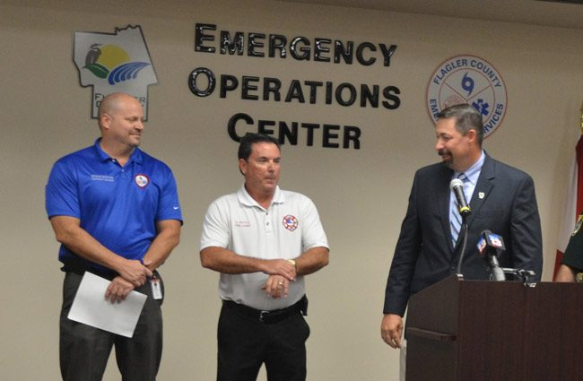 It's long been an uneasy relationship between Emergency Manager Steve Garten, left, Fire Chief Don Petito, center, and County Administrator Craig Coffey, who's been steering the emergency management division as its de facto chief. (c FlaglerLive)