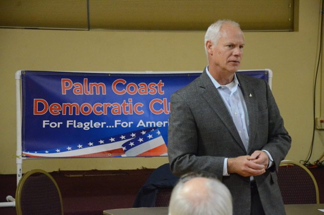 Bob Coffman, an airline pilot, during an appearance at the Palm Coast Democratic Club in January. (© FlaglerLive)