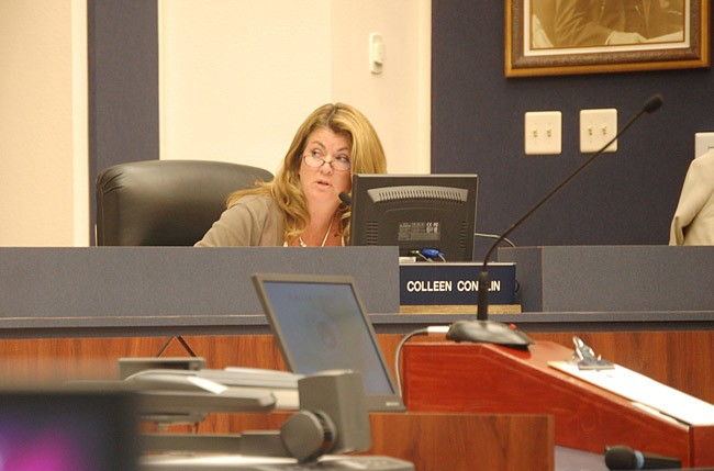 Colleen Conklin is the odd one out on this one: the Flagler County School Board member considers herself 'on the fence' regarding allowing concealed guns in schools, while her colleagues, among them Andy Dance and Sue Dickinson, pictured here, are more comfortable sticking with school resource deputies. (© FlaglerLive)
