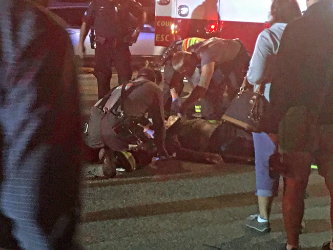 The scene on A1A and South 7th Street in Flagler Beach this evening as paramedics worked on a man struck by a vehicle on State Road A1A. (© FlaglerLive)