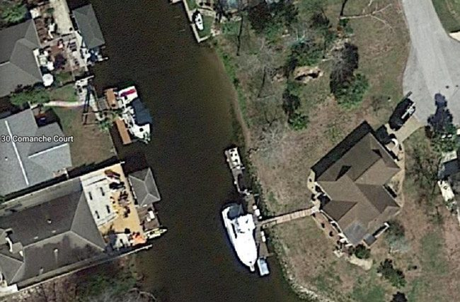 John M. Clark was living on a boat docked at 30 Comanche Court in Palm Coast.