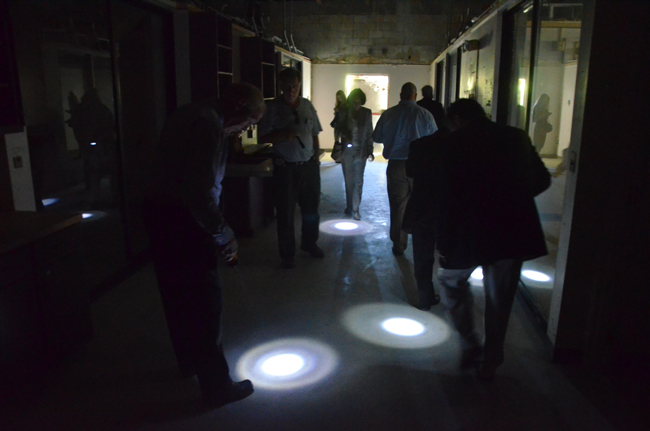 Flagler County Commissioners, seen here during their walk-through of the old hospital in May, are flashing their way to acquisition. (© FlaglerLive)