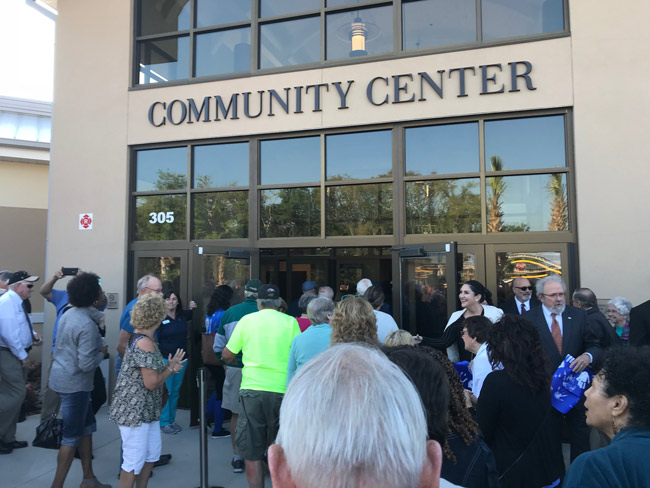 The ribbon-cutting at the renovated Palm Coast Community Center, an $8 million, 13-month project, drew a crowd Friday. (© FlaglerLive)
