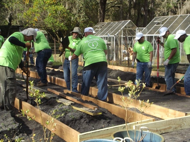 Volunteers at work this week, giving the Community Garden in Bunnell a big make-over.