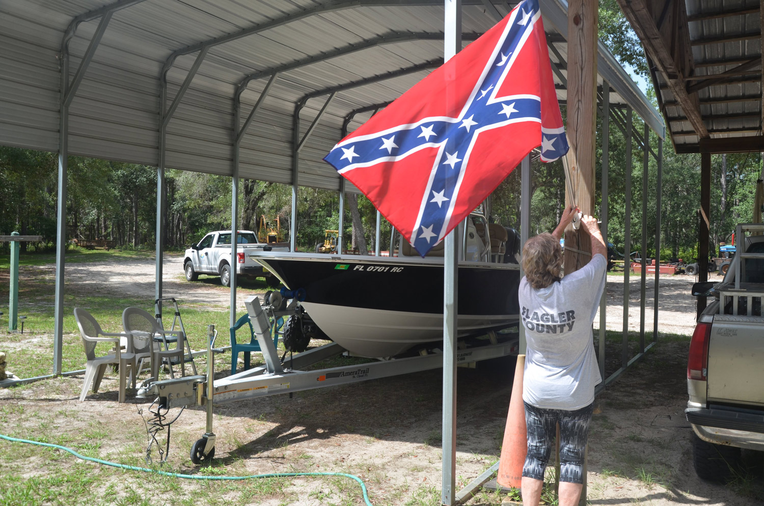 'I don't go around advertising that flag, I don't go around advertising nothing.' Gail Durrance said, taking down the Confederate flag she flew at the Princess Place Preserve, against a 'barn' used by county employees for their park vehicles and equipment. (© FlaglerLive)
