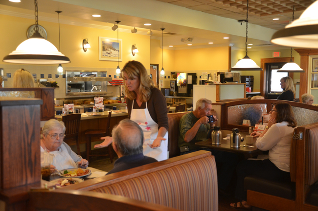 School Board member Colleen Conklin, waitress. Conlin put in the noon to 1 p.m. shift at Bob Evans today, but the fund-raiser for the district's Student Services runs all day, through 9 p.m. (c FlaglerLive)