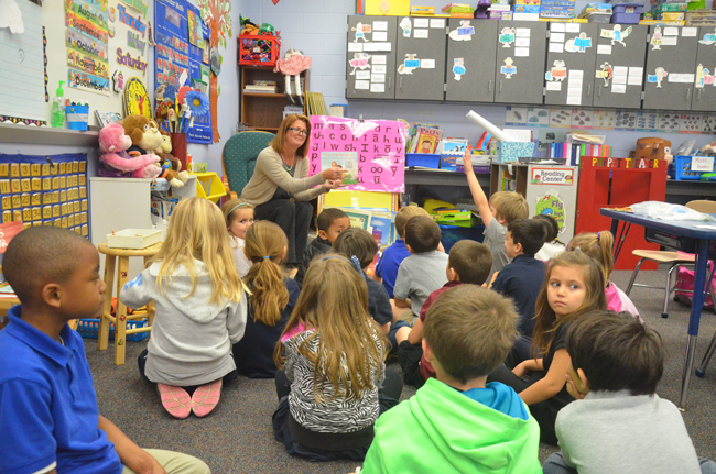 It pays off: School Board member Colleen Conklin reading to students at Belle Terre Elementary earlier this year. (c FlaglerLive)