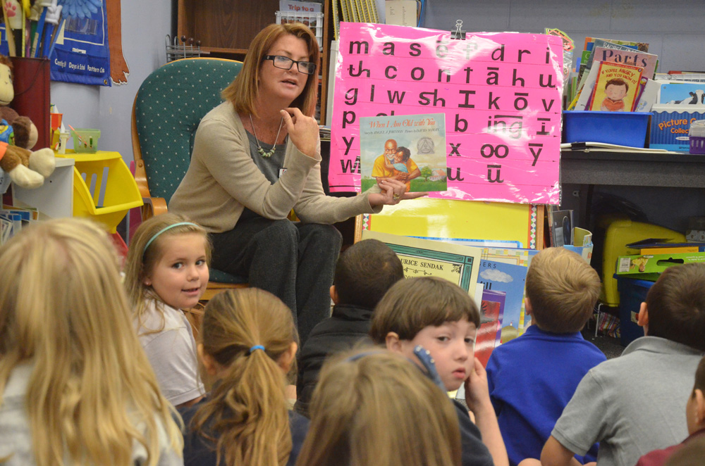 School Board member Colleen Conklin reading to students at Belle Terre Elementary School. (© FlaglerLive)