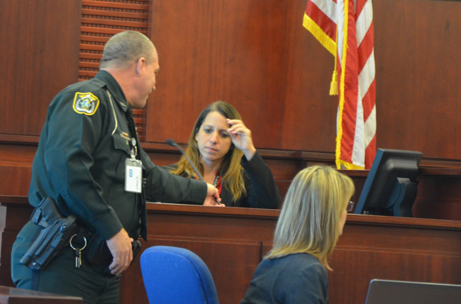 Flagler County Sheriff's Detective Annie Conrad preparing to testify in a murder trial last month. Her role in the case, which led to a conviction for first degree murder, was cited among the reasons she was named Law Enforcement Officer of the Year. But she has been on medical leave for weeks due to sickness she attributes to the sheriff's Operations Center. (c FlaglerLive)