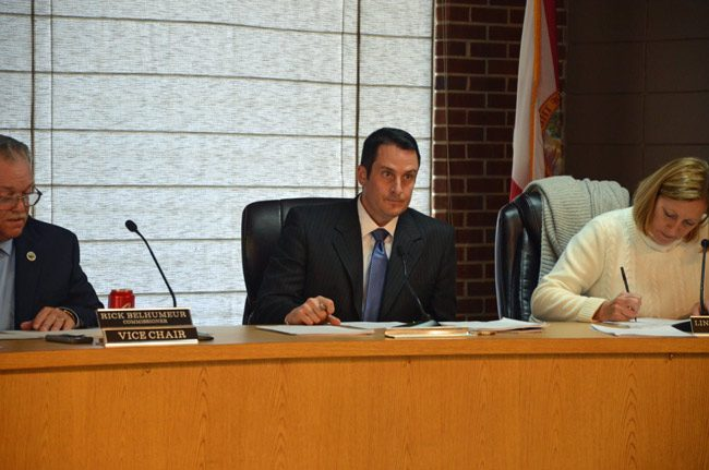Flagler Beach Commissioner Eric Colley, center, did not get the support he was hoping for when he proposed looking into contributing money to the school district's school resource deputies' budget. (© FlaglerLive)