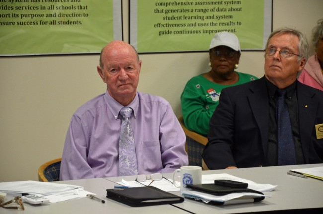 Jerry Copeland, left, Bill McGuire, and behind McGuire, Jerusha Logan, a community member who's been critical of the district's search process. Click on the image for larger view. (© FlaglerLive)