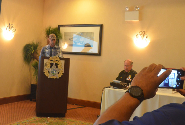 Corey Miller, who described himself as a perpetrator and a victim of domestic violence across generations, was among the speakers at today's summit at the Hilton Garden Inn. The summit was convened by Sheriff Rick Staly, right. (© FlaglerLive)
