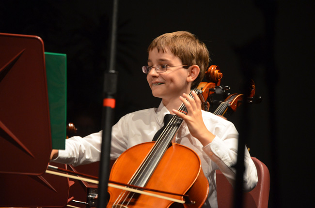 Corey Prior, a cellist and middle school students, has been a member of the Flagler Youth Orchestra for four years. (© FlaglerLive)