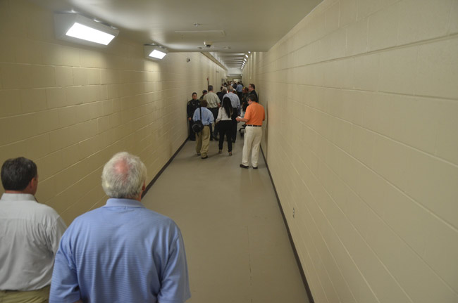 The gas leak was traced to water heaters stored in a room behind this long corridor at the Flagler County jail, which connects the old portion of the jail with the new. The corridor is seen here during last July's open house, before inmates were moved into the newer portion of the jail.l (© FlaglerLive)