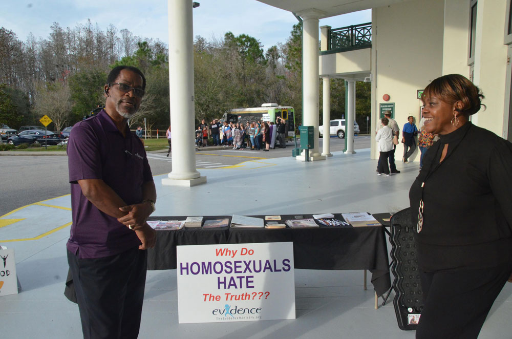 """Charlene Cothran, right, a pastor in Flagler, successfuylly lobbied the Flagler County School Board to keep the words v""""gender identity"""" out of an anti-discrimination policy earlier this year. Cothran is seen above during demonstrations for and against protections for LGBTQ students  Nathaniel Wilcox, a member of Cothran's board"""