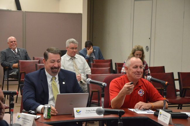 Flagler County Fire Rescue's Jamie Burnsed, a battalion chief, right, led a discussion before the County Commission this afternoon on using drones in public safety and beyond, with County Administrator Craig Coffey. (© FlaglerLive)
