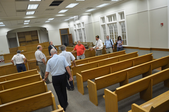 Members of the committee with county administrative staff and a commissioner during a visit to the old courthouse in June. (© FlaglerLive)