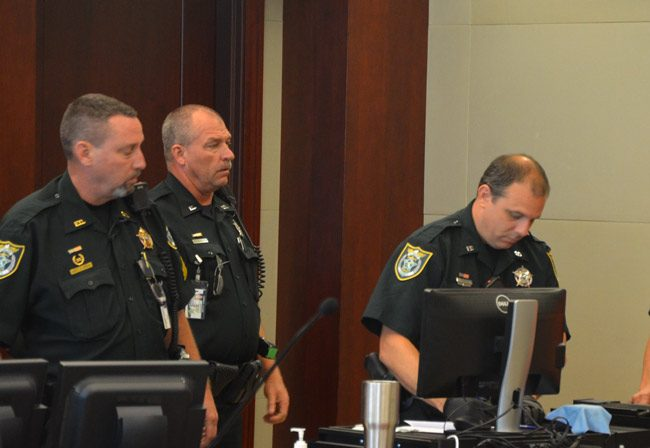 Three of the Flagler County Sheriff's deputies assigned to courthouse duty that were named in internal inquiries, and that led to a shake-up at the courthouse: from left, Sgt. John Bray, who lost his position as a supervisor of courthouse bailiffs and was assigned desk duty at the Palm Coast Precinct, Jonathan Freshcorn, whose duties are unchanged, and Jeffrey Puritis, who has twice been disciplined since November and was re-assigned, a few weeks ago, to road patrol. He had been assigned to Judge Dennis Craig. (© FlaglerLive)