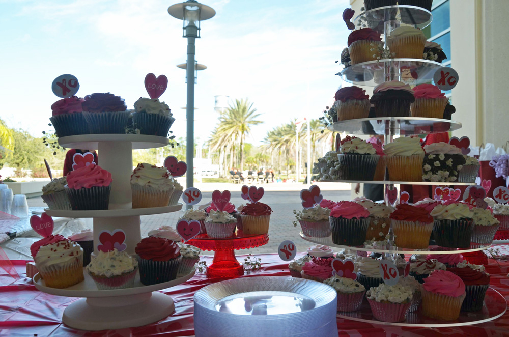It's a big party: the Valentine's Day wedding ceremony on the courthouse steps includes lots of goodies for couples and their guests. (© FlaglerLive)