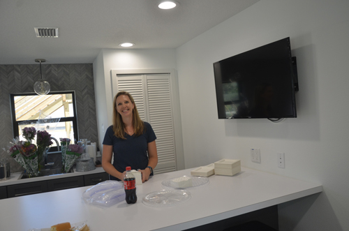 Kristi Furnari of Ripple Coworking, in one of the building's common areas. (c FlaglerLive)