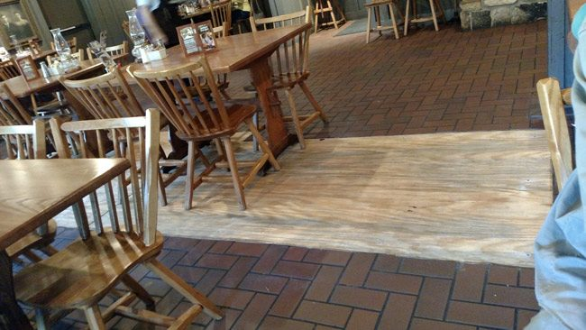 Plywood this morning had replaced the tile that had crackled at Cracker Barrel Tuesday evening. (Paul Easter)