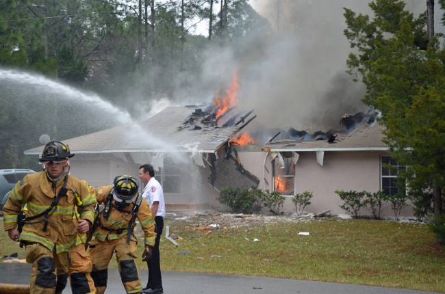 2013 began with a crash: a plane fell into a house on Utica Path, killing three aboard. Click on the image for larger view. (© FlaglerLive)