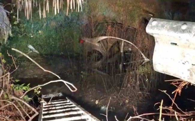 A still from a video shot by Flagler firefighters showing the silver car in the canal off State Road 100 Sunday night.