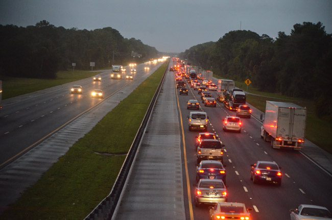 A crash with injuries stalled traffic on I-95 north just past the Palm Coast Parkway intersection this evening at sundown--not what travelers fleeing south Florida, ahead of Hurricane Matthew, wanted to see. (© FlaglerLive)