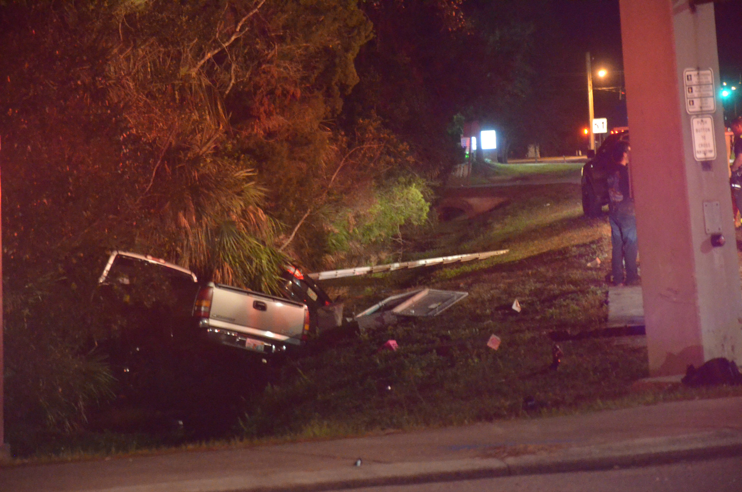 Both vehicles ended in the ditch at the south side of westbound Palm Coast Parkway. (c FlaglerLive)