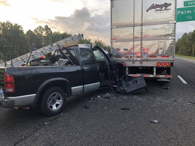 The driver of the pick-up truck had to be extricated after he crashed into the back of the semi, near the Matanzas Woods exit. The driver of the semi had crashed into another semi, and was killed. (Flagler County Professional Firefighters)